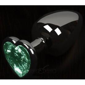 Графитовая анальная пробка с зеленым кристаллом в виде сердечка - 6 см.